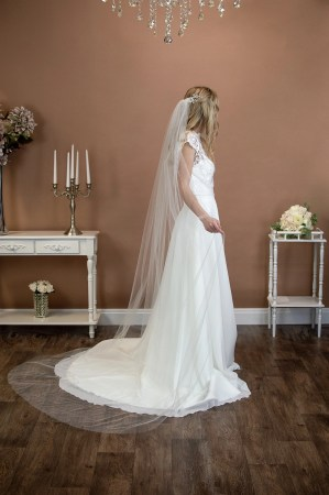 Skye - beautifully plain long hand cut single layer long chapel length wedding veil on a bride