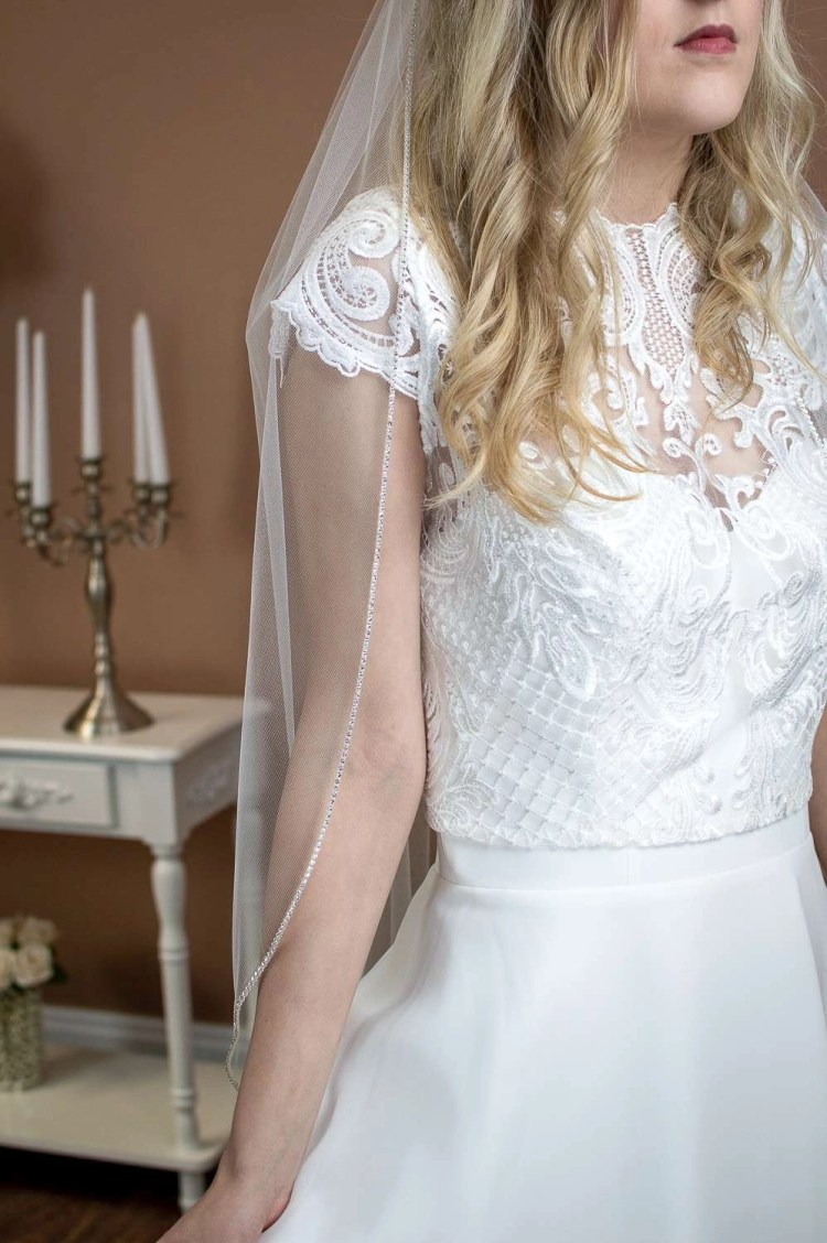 Sophia - single layer hip length veil with a sparkly rhinestone edge front closeup