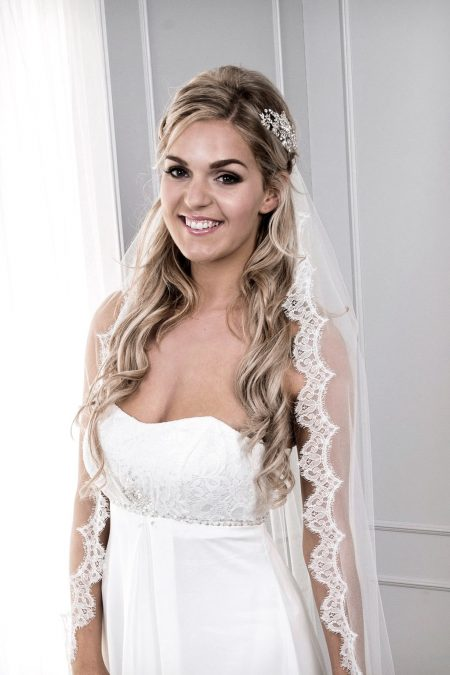 Close up of bride in veil with French lace edge