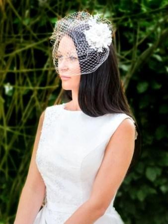 Bride wearing lace birdcage veil tlh3042