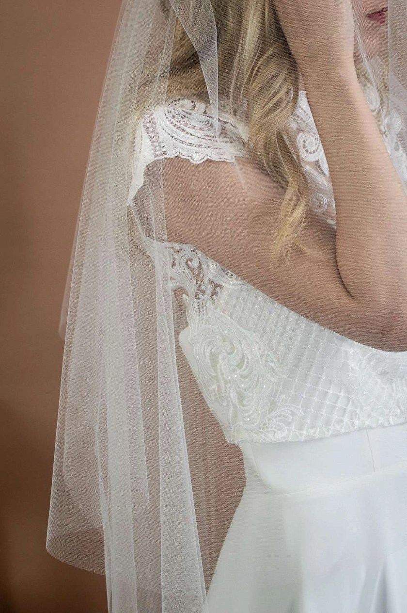 Angelina - two layer plain wedding veil with a hand cut edge in waltz length closeup side view