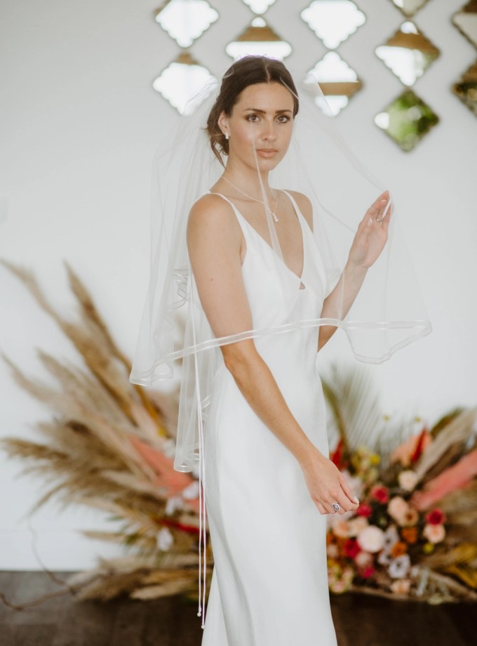Candice - two tier hip length veil with a satin & organza ribbon edge