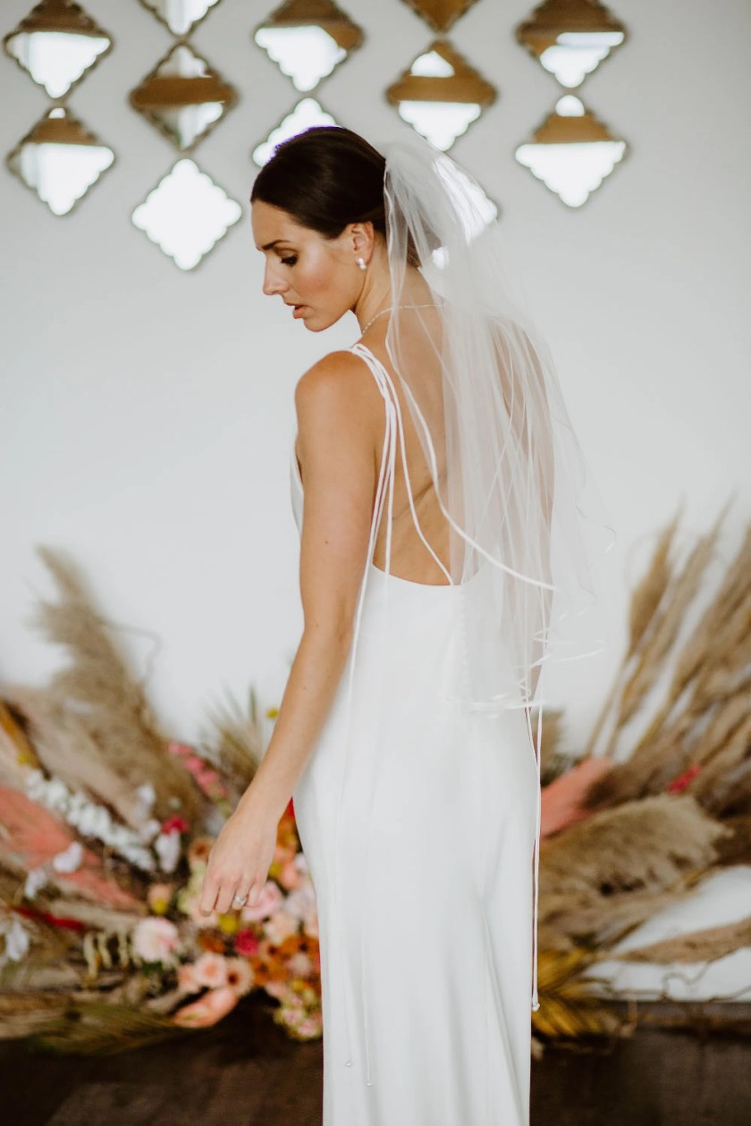 Daisy – one layer waist length veil with a pretty narrow ribbon trim back