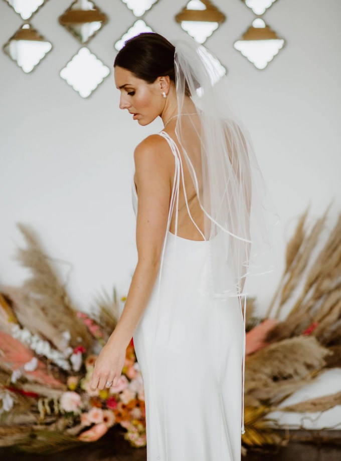 Daisy – one layer waist length veil with a pretty narrow ribbon trim back