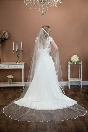 Freya - one layer chapel length waterfall cut veil with a satin binding edge on a bride