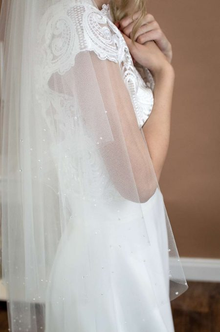 Larissa - two layer hip length veil with a cut edge and a pearl and crystal border side closeup
