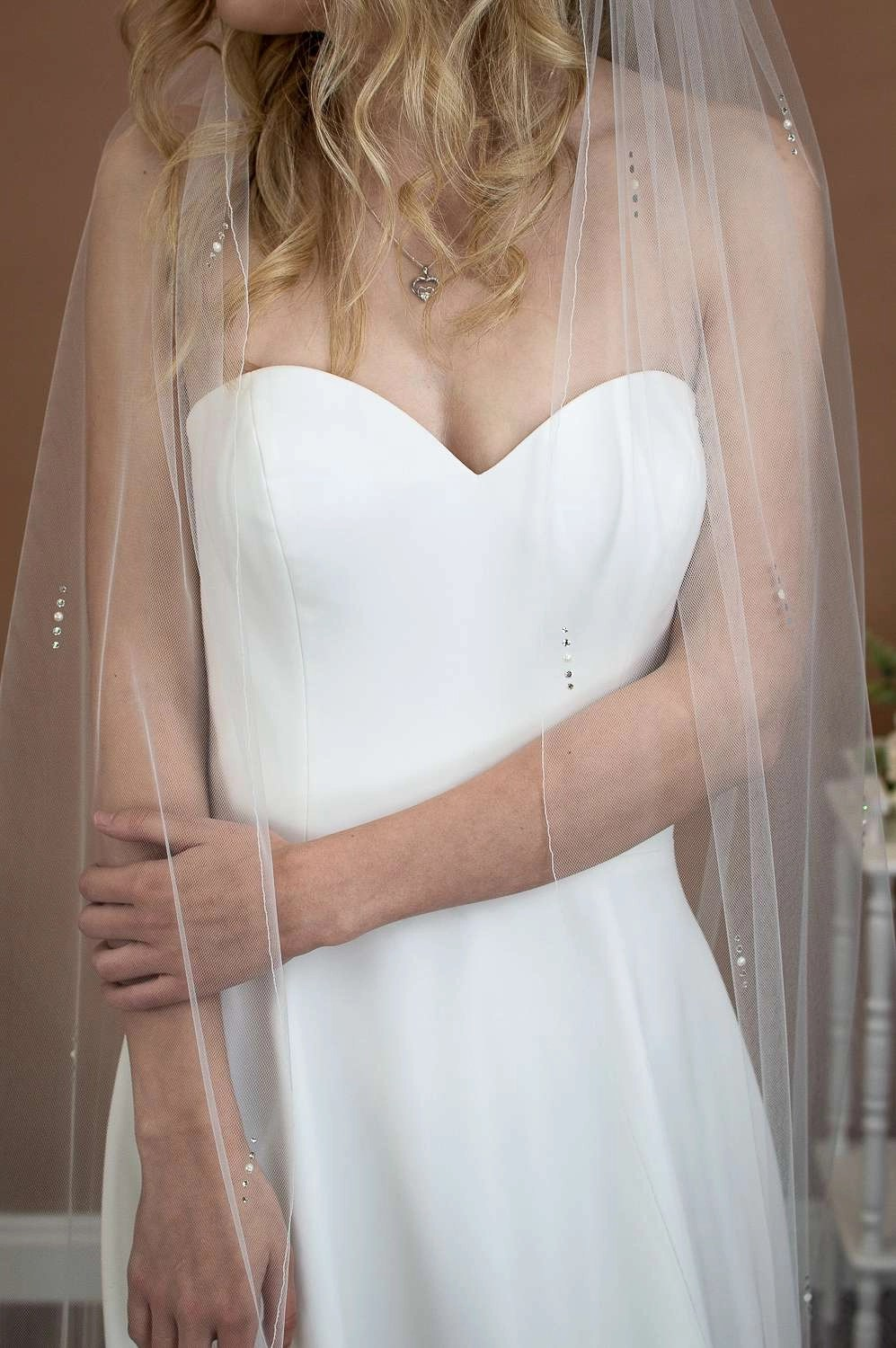 Lola - one layer chapel length veil with a pearl and diamante design front closeup