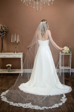 Scarlett - extra long one layer cathedral veil with sequined lace appliques around the bottom on bride