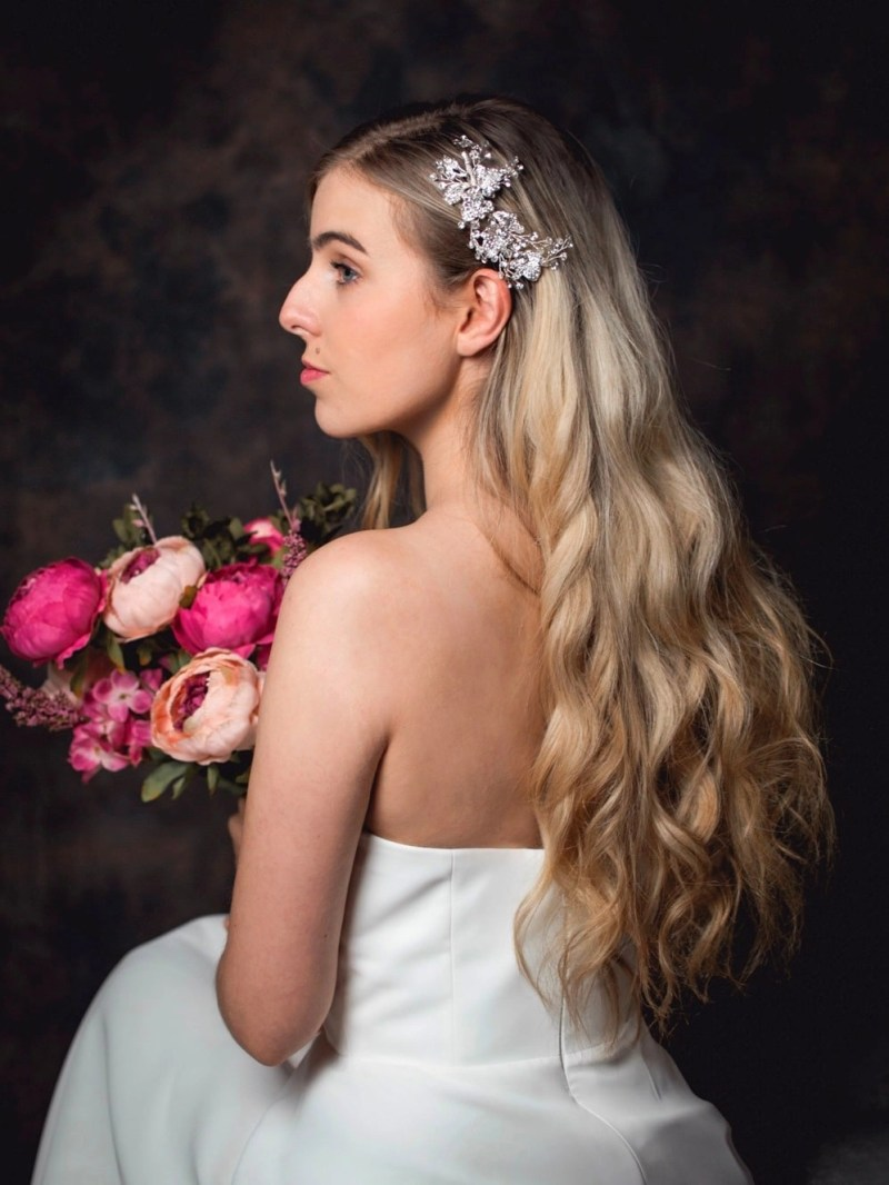 Hermione - classic bridal hair comb with floral details on model bride TLH3003