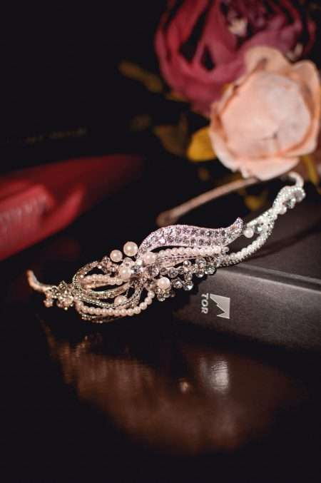 Vivien - pearl & diamante side headband with a scrolling design closeup TLT4578