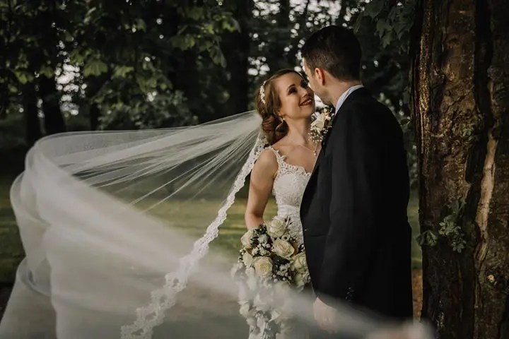 Natalie wearing T666 Paris lace veil in chapel length - photography by Beth Faulder Photography