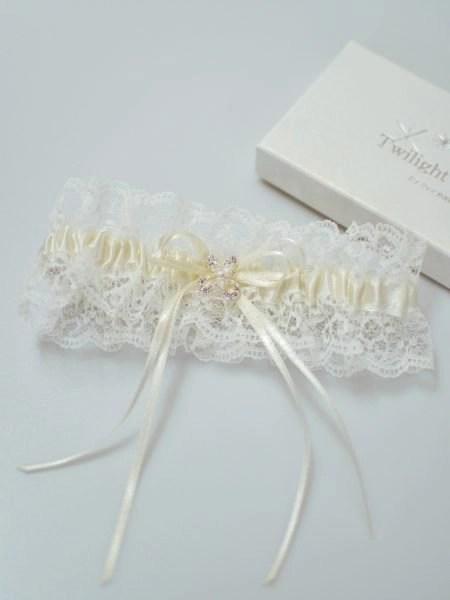 Pretty wedding garter with crystal detailing flatlay TLG512