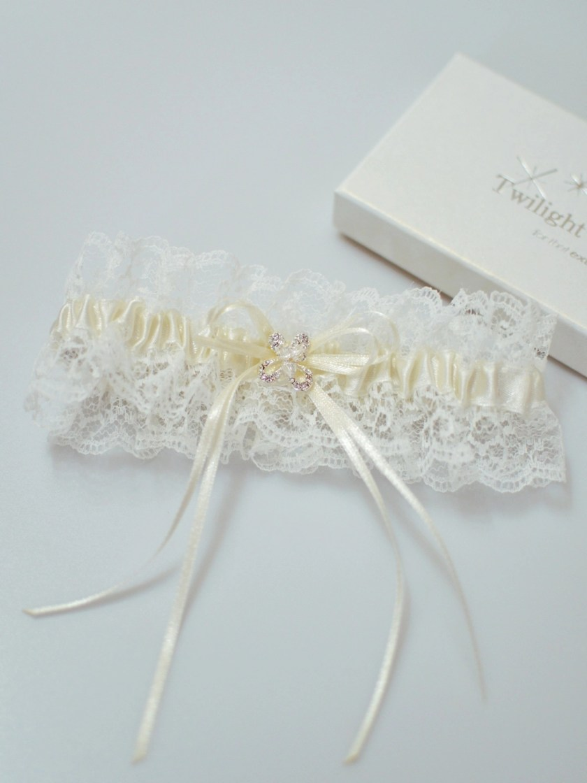 Pretty wedding garter with crystal detailing flatlay TLG512