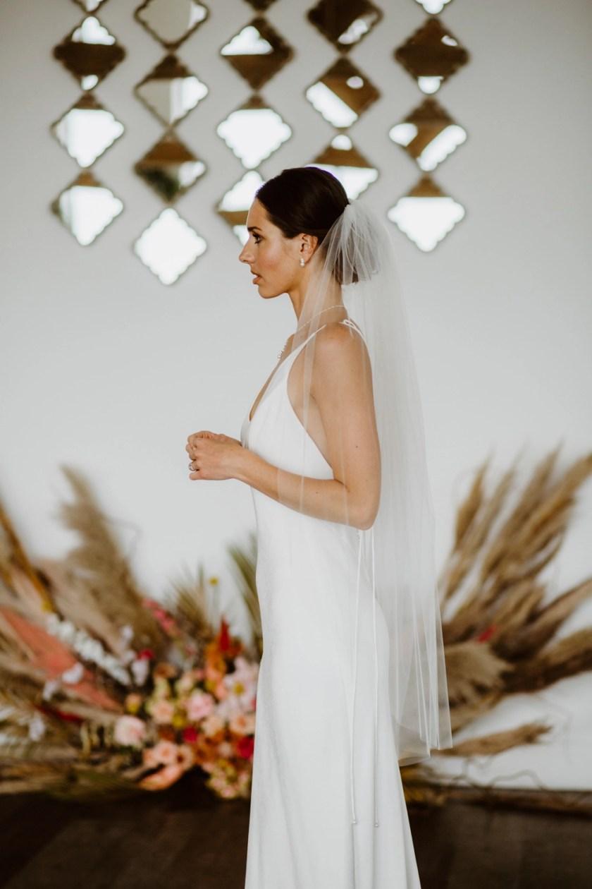 Tina - one tier plain cut edge wedding veil in fingertip length