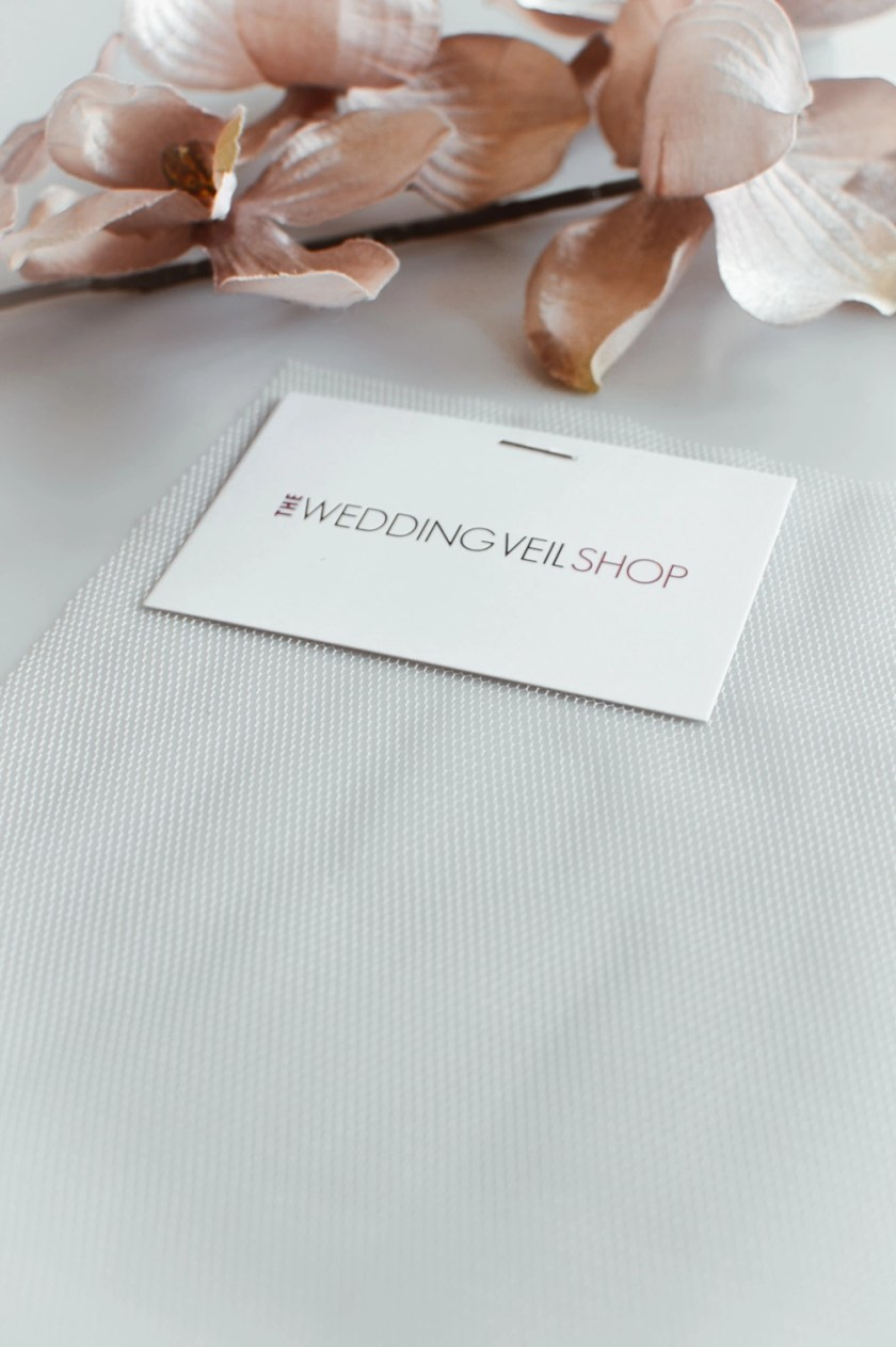 Silk effect ivory veil tulle samples isolated
