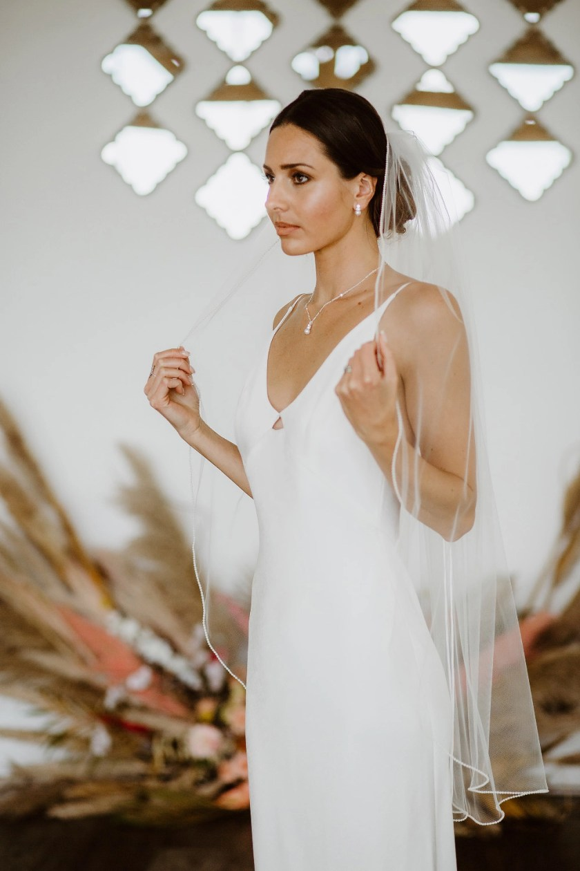 Tania - one layer fingertip length veil with a pearl edge
