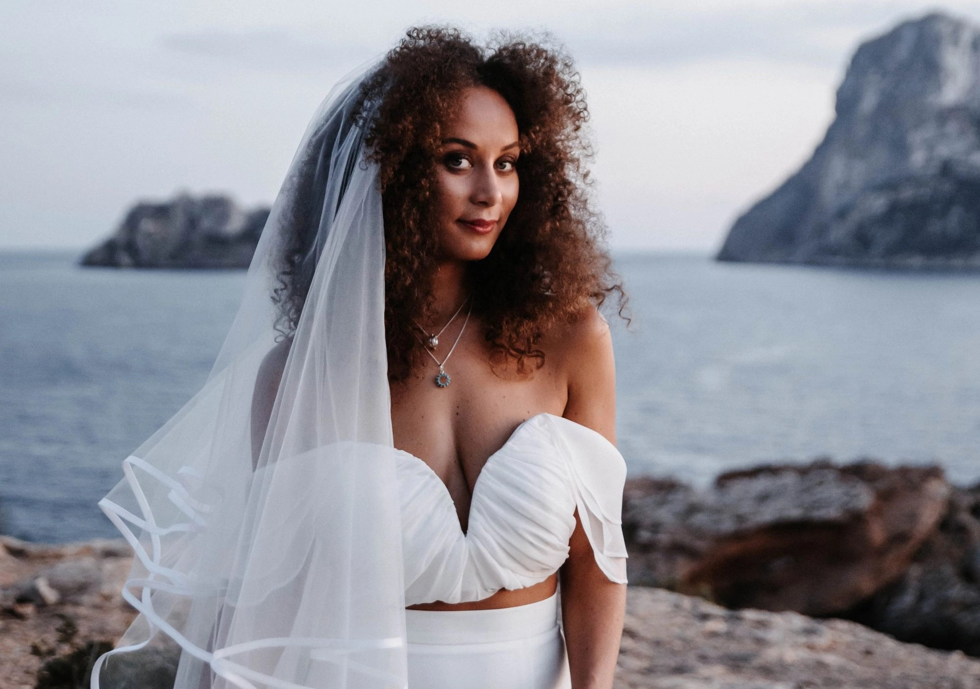 Styled Shoot in Ibiza featured imaged of a bride in a long veil with hair down