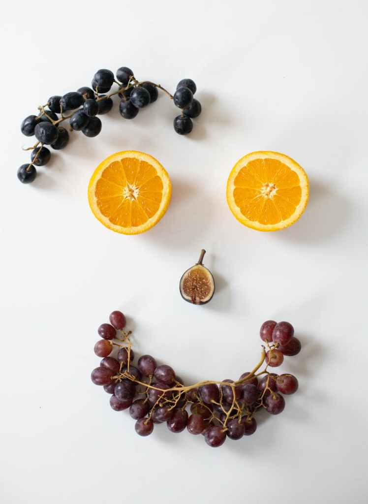 composition of fruits assorted as smiling face