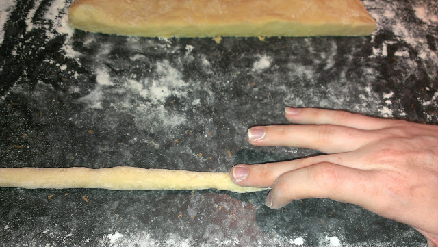 Roll the Gnocchi into sausages to your preferred thickness then cut into small squares.