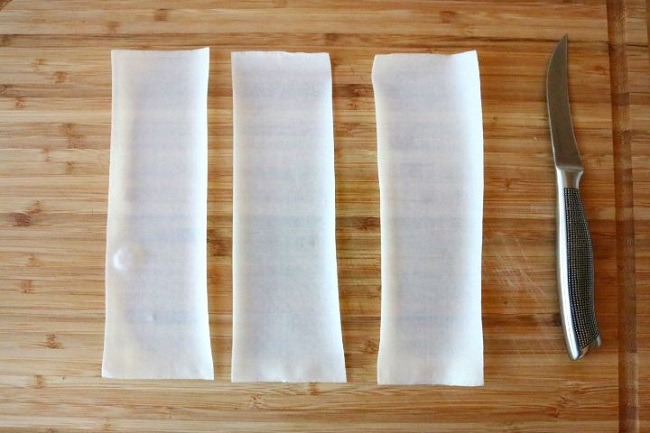 Cut the Spring Roll wrappers into 3 strips.