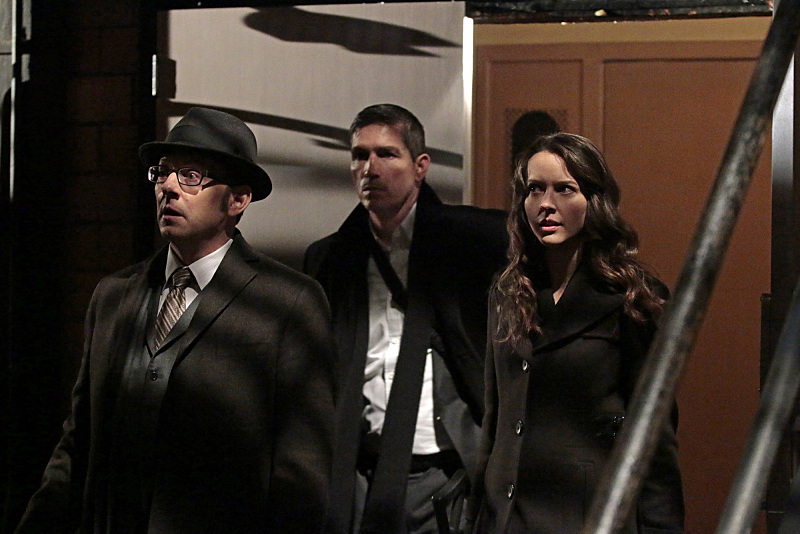 """YHWH"" -- Finch (Michael Emerson, left) and Root (Amy Acker, right) race to save The Machine, which has been located by the rival AI, Samaritan, while Reese (Jim Caviezel, center) is caught in the middle of the final showdown between rival crime bosses Elias and Dominic, on the fourth season finale of PERSON OF INTEREST, Tuesday, May 5 (10:01-11:00 PM, ET/PT) on the CBS Television Network.  Photo: Giovanni Rufino/Warner Bros. Entertainment Inc. © 2015 WBEI. All rights reserved."