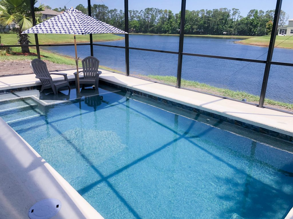 Plunge pool, small pool ideas, pool inspiration, small backyard pool, Florida lifestyle, pool with sun shelf, lagoon style pool, modern plunge pool, outdoor oasis, #lifestyleblog