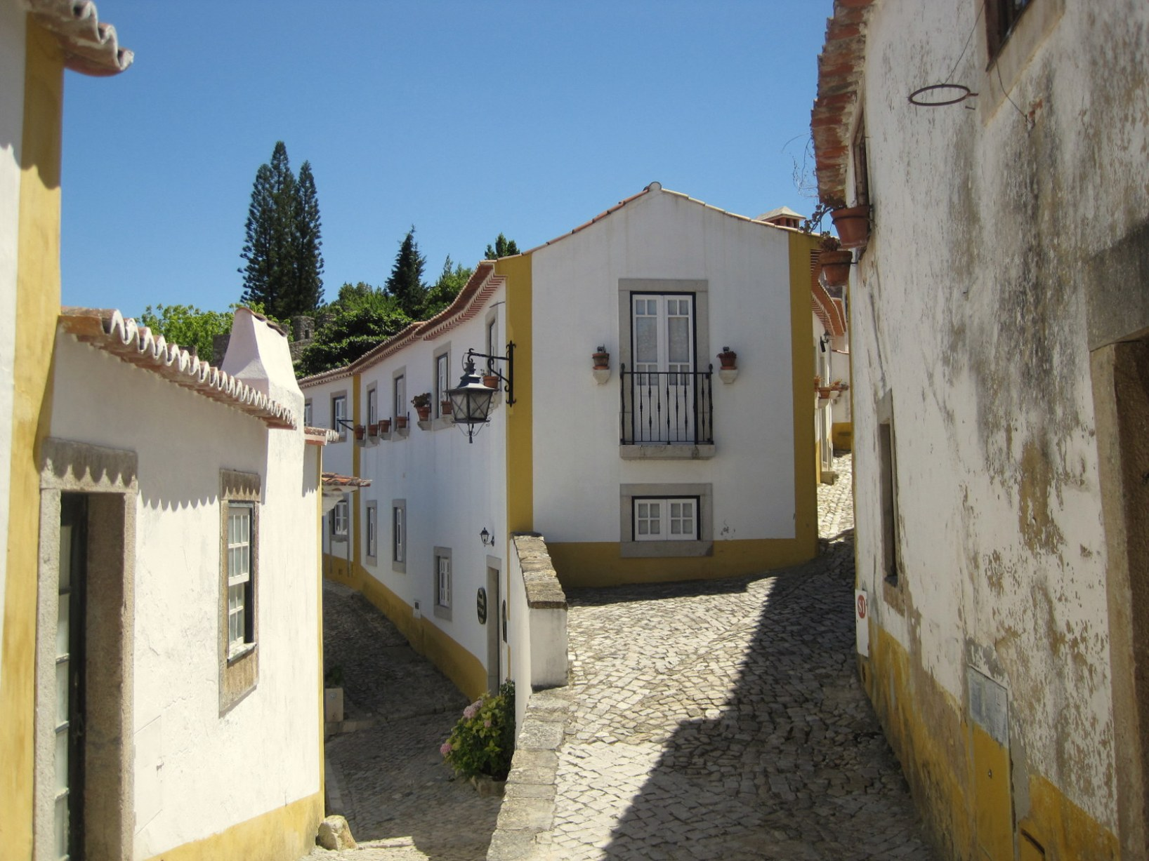 7 places to visit in Portugal - Obidos - A medieval town on a hillside, Obidos is simply breathtaking. Walk the old city walls and get views over the village. Wander the streets and see the charming shops and houses covered in flowering vines.