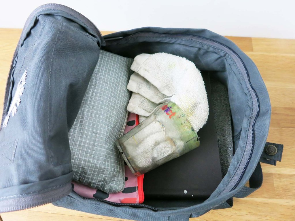 All packed up with art supplies, the Kanken Mini is not at all full and can still easily fit snacks, a small sweater and water.