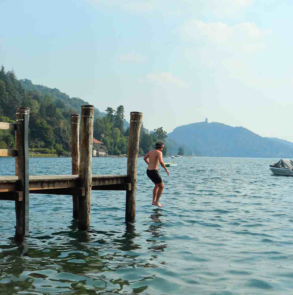jumping into lago d'orta