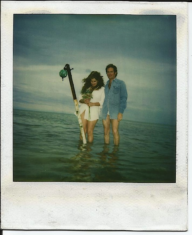 "Suzi and David Feder make their home in Islamorada after being set up on a blind date by their parents.  The photo above was taken on Suzi and David's wedding day with a Polaroid 600 on a self timer, bungied to a guitar stand which was stuck ina the mud near the shore in Lower Matecumbe. ""Dave had to push the button and run a few times before we got a good shot,"" Suzi said."