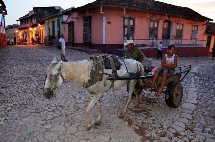 The streets of the old colonial city of Trinidad on the south middle coast of feature cobblestone streets made of old ballast stones from colonial ships. Horses and oxen are used frequently as transportation and to till the fields. Cutlines: LARRY BENVENUTI/contributed