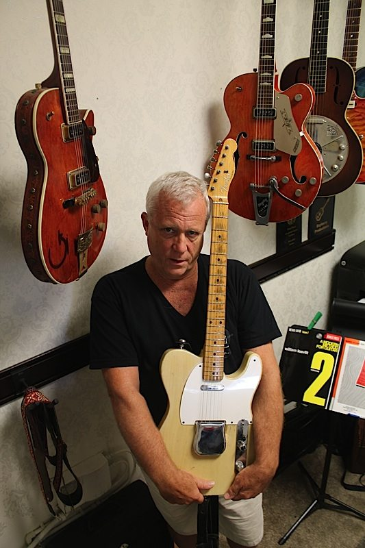 The classics: Daryl Brooke stands with a recently sold 1957 Fender Telecaster, while a1937 National Trovador, a 1955 Gretsch Roundup and a 1957 Chet Atkins Gretsch hang in his office.