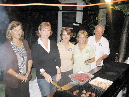 Centennial Bank did not bring the hot dogs to the Crane Point Full Moon Party. How about marinated beef tips and shrimp? Pictured, from left: Teresa Condas, Melissa Grady, Jackie Grasley, JoAnn Wagner, and Bob Moore