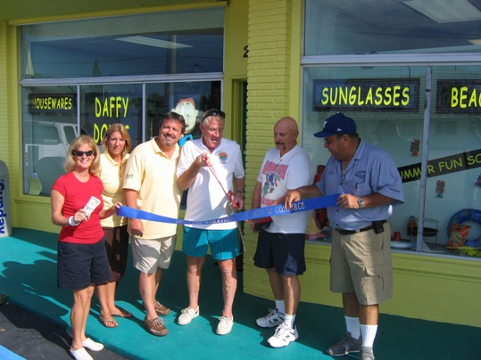 Daffy Dougs Discount Dollar Store opened on May 23 to much fanfare and is already exceeding expectations. Pictured, from left: happy patron CM Bishop, Leanne & Doug Austin, City Councilman Dick Ramsay, wealthy gadabout Dennis Bishop, and Man-of-Many-Titles Mike Puto
