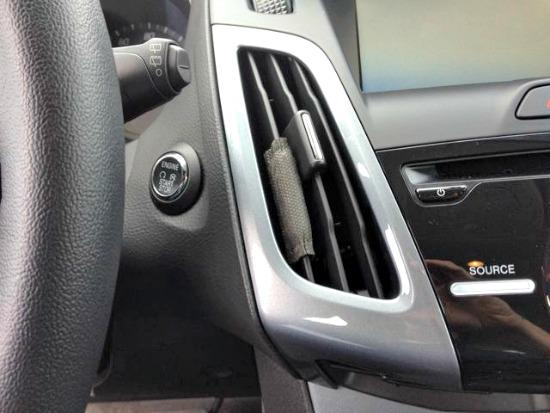 Perk Vent Wrap air freshener installed on vent of a 2014 Ford Focus.