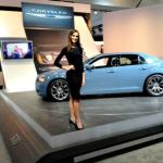A product specialist at the LA Auto Show in front of the 2014 Chrysler 300.