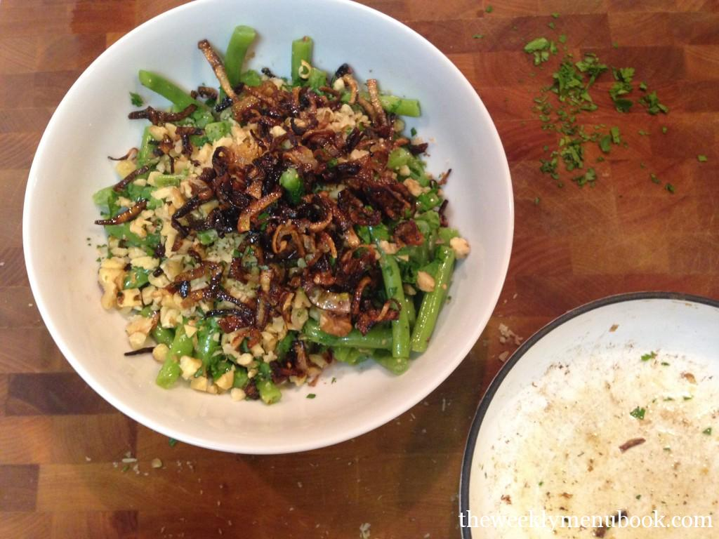 green beans tossed in vinaigrette with toasted walnuts and fried shallots