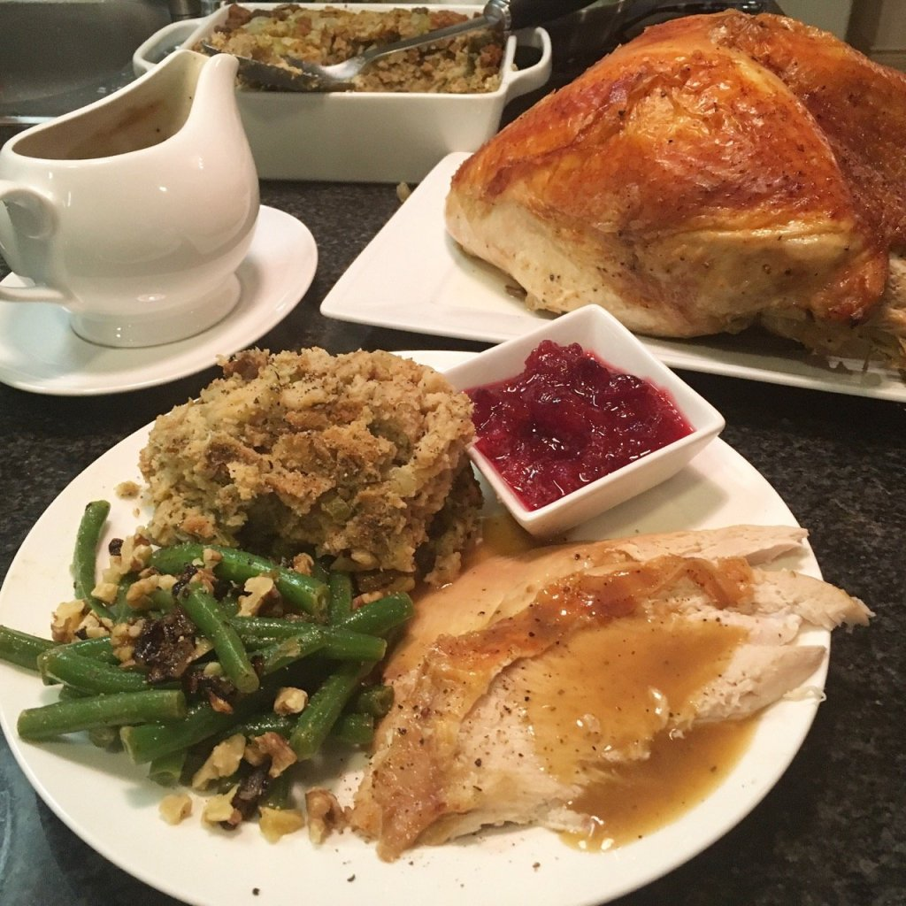 turkey dinner for thanksgiving with fancy green beans and good gluten-free stuffing