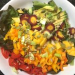 salad with mango, black beans, wild rice, avocado, tomato, and more veggies