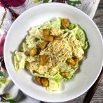 caesar salad with homemade dressing, gluten-free croutons and parmesan cheese