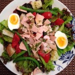 salad nicoise with green beans, potatoes, eggs, tomatoes and turkey