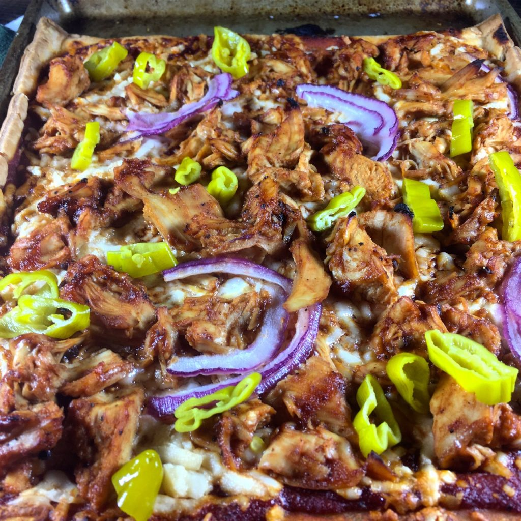 Gluten-Free BBQ chicken pizza with a Schär puff pastry crust and using Salt Lick honey pecan BBQ sauce