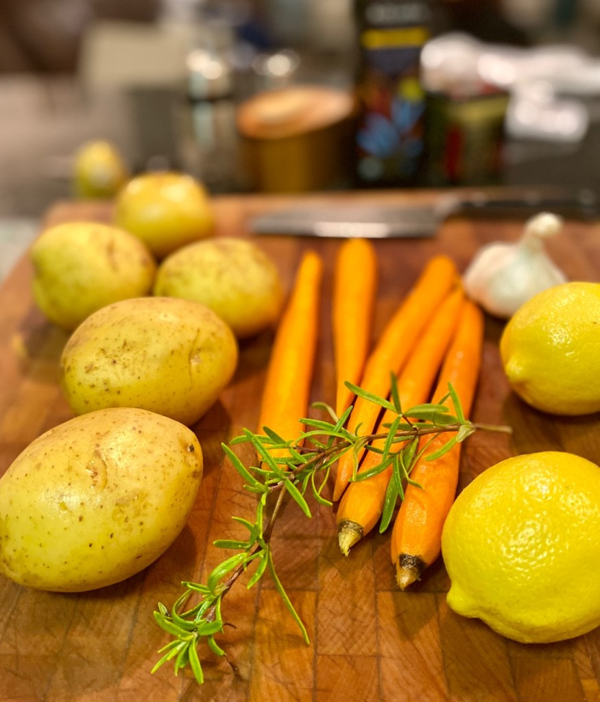 Prep For Making Dinner consists of potatoes, carrots, lemons, garlic and rosemary