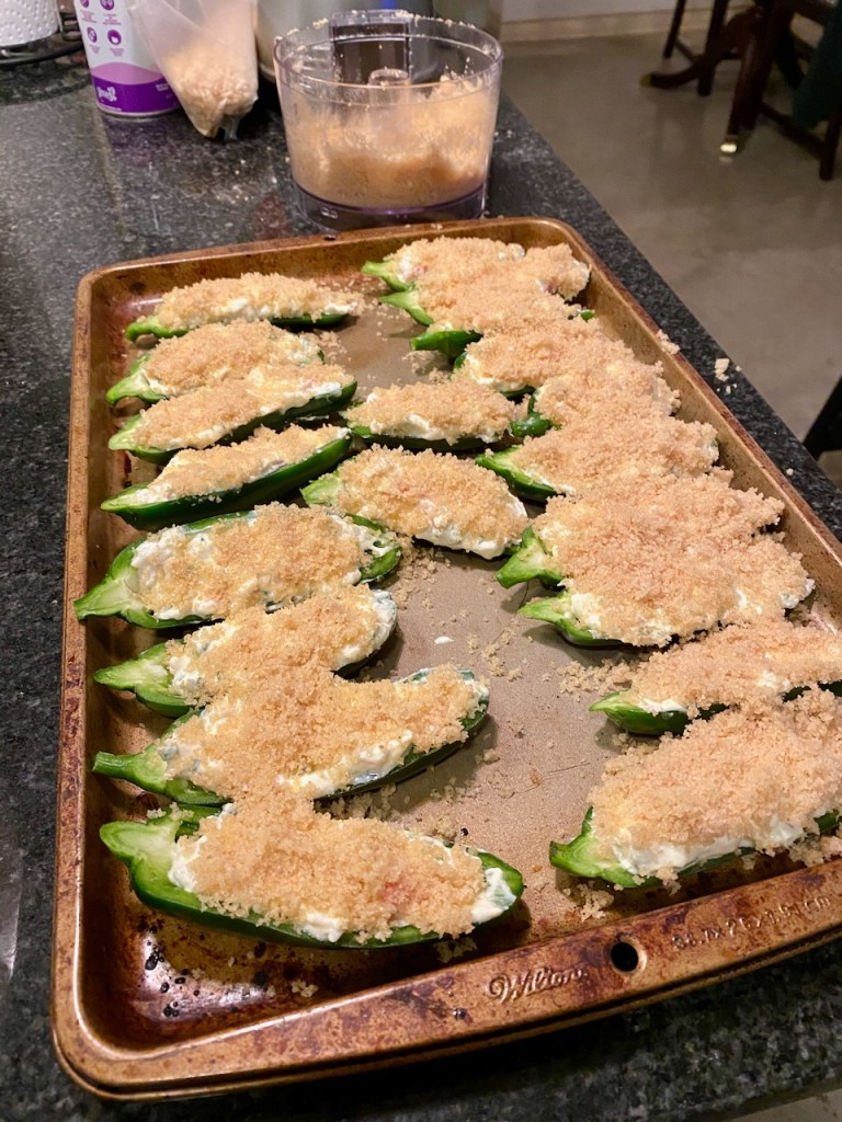 Awesome Crab and Goat Milk Cream Cheese Stuffed Jalapeño Poppers before baking topped with crushed rice cereal and butter mixture