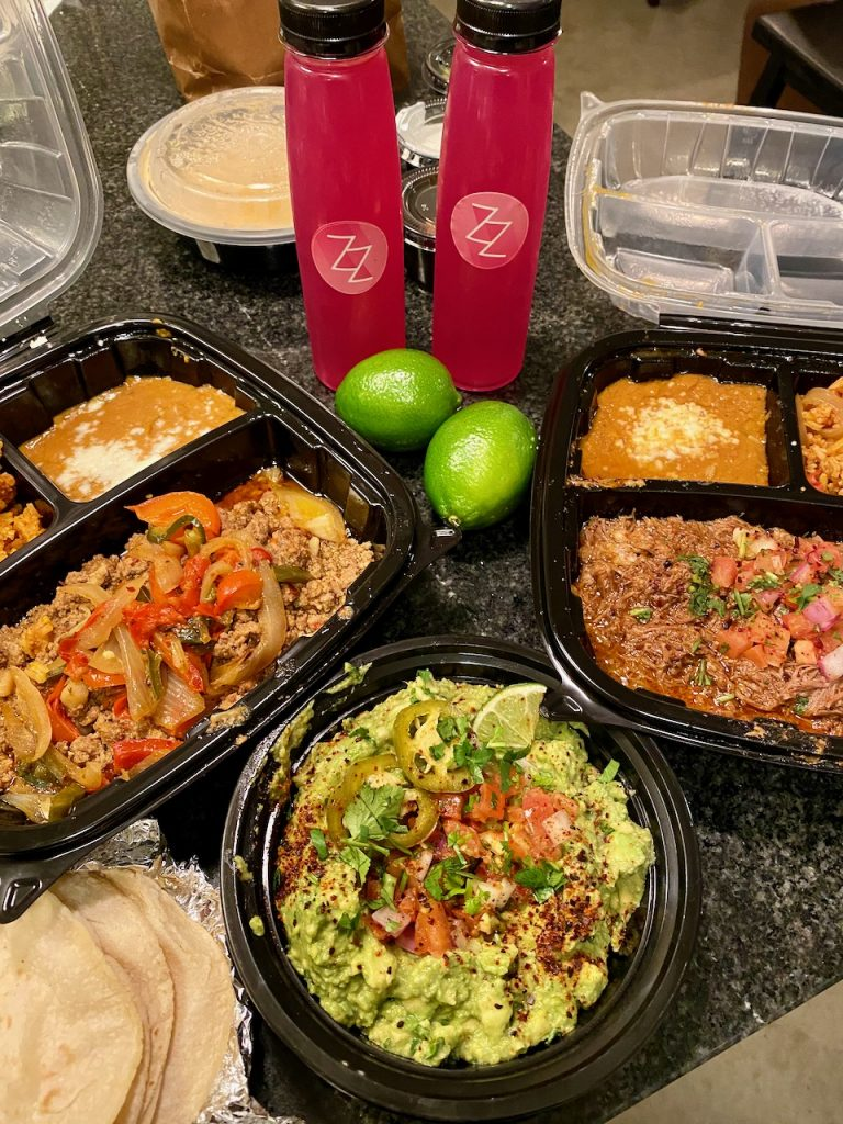 Grizzeldas Party Pack with Guac, and Grizz-Mizz Margaritas, as well as Picadillo and Barbacoa Taco Plates