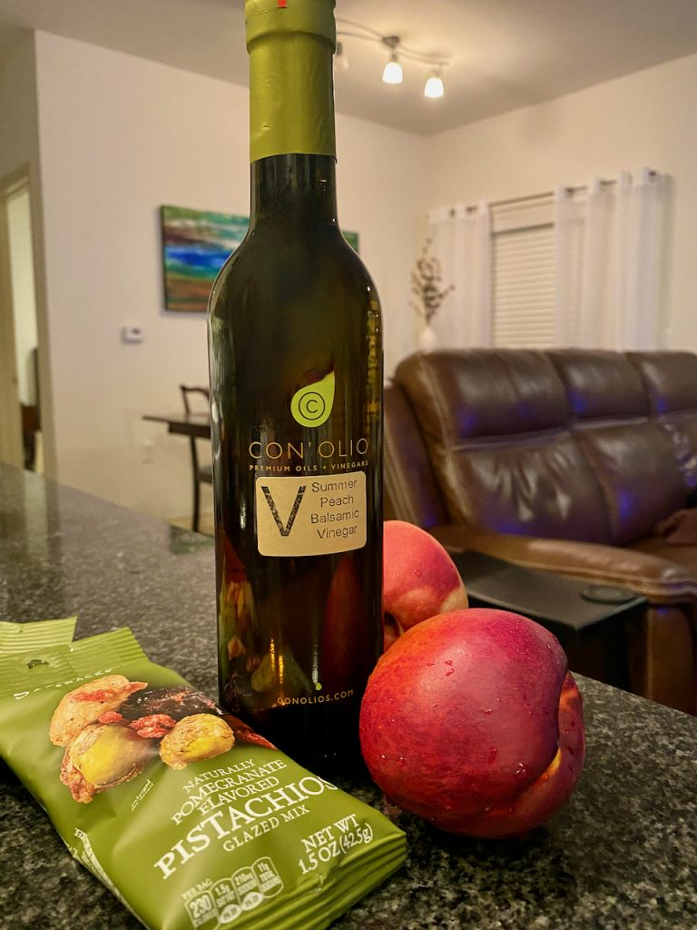 Sahale pomegranate flavored pistachios nut mix and Con' Olio summer peach balsamic vinegar, and  nectarines