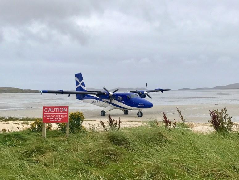 Plane landing at Barra Airport