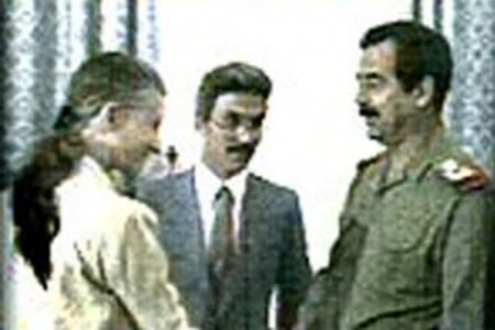 April Glaspie (left) meets with Iraqi dictator, Saddam Hussein. This fateful meeting would lead to Saddam misinterpreting American diplomatic ambivalence regarding his toxic rhetoric against his neighbor, Kuwait, as implicit permission for him to invade Kuwait.