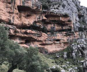 Rocky cliffs dotted with ancient natural caves