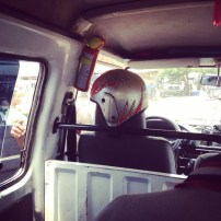 Never get on a tro where the driver has a crash helmet. The fire extinguisher is standard issue.